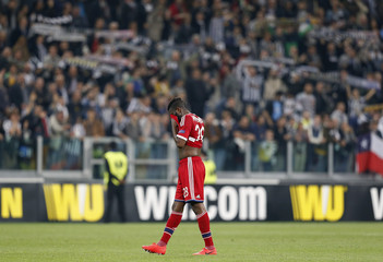 Olympique Lyon's Arnold Mvuemba reacts after losing the second leg of their Europa League quarter-final soccer match against Juventus at the Olympic stadium in Turin
