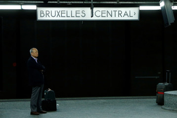 A traveller waits on a platform at a railway station during a strike of Belgian public sector workers in Brussels