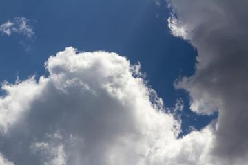Storm clouds on a blue sky