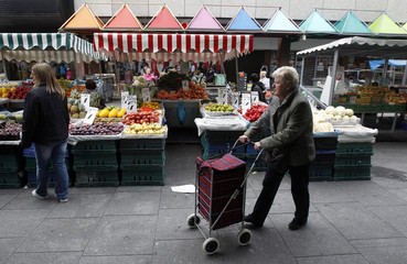 Shoppers buy Fruit and Vegetables from market stalls on the north side of Dublin