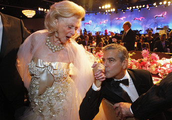 Clooney kisses the hand of Davis during the 26th Carousel of Hope Ball in Beverly Hills