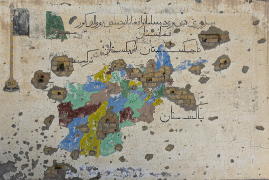A bullet riddled map of Afghanistan is seen painted on a wall of an abandoned Canadian-built school in Zharay district of Kandahar province