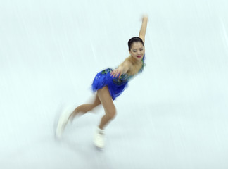 Suzuki of Japan performs during the women's free skating at the ISU Grand Prix of Figure Skating Final in Sochi