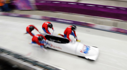 Pilot Zubkov of Russia and his teammates start during a four-man bobsleigh training event at the Sanki Sliding Center in Rosa Khutor, during the Sochi 2014 Winter Olympics