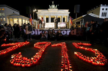 The year 1915 is formed with candles during a memorial march by Armenians in front of the Brandenburg Gate in Berlin