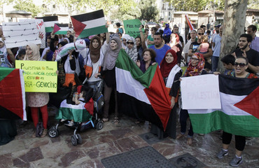 Demonstrators shout slogans during a protest calling for an end to the Israeli air strikes on Gaza, in Valencia