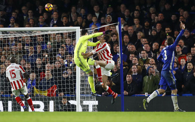 Chelsea's Thibaut Courtois in action with Stoke City's Peter Crouch