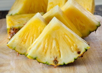 pineapple sliced  on wooden background