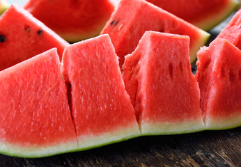 watermelon sliced on wooden background