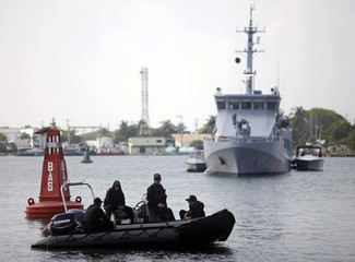 Colombian police patrol the harbor near the convention center where the Summit of Americas will be held in Cartagena