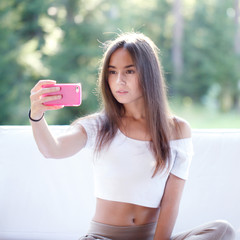 Girl take picture with smartphone