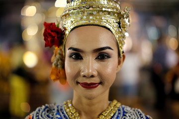 A thai classical dancer poses for photos at the Erawan shrine in central of Bangkok