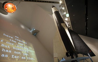 An original German World War Two V2 rocket is pictured next to the landing unit used by first East German cosmonaut Sigmund Jaehn at the Museum of Military History in Dresden