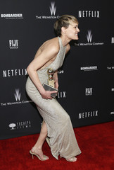 """Wright holds her award for Best Actress in a TV Series, Drama for her role in """"House of Cards""""  after the 71st annual Golden Globe Awards in Beverly Hills"""
