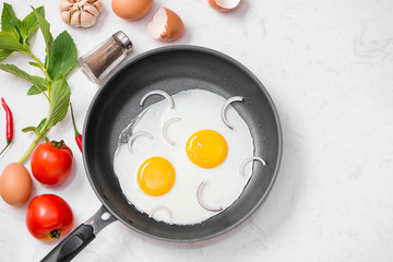 Aluminium Prints Egg Fried eggs in a frying pan with cherry tomatoes and bread for breakfast