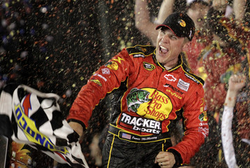 Jamie McMurray celebrates in victory lane after driving his Chevrolet to victory in the NASCAR Sprint Cup Series Daytona 500 race at the Daytona International Speedway