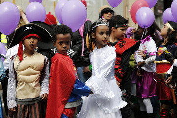 Children in costumes prepare for a parade celebrating the Jewish holiday of Purim outside the Bialik Rogozin school in south Tel Aviv