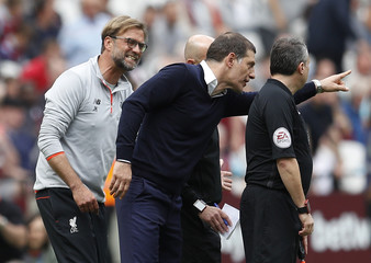 West Ham United manager Slaven Bilic appeals to the officials after Liverpool's third goal as Liverpool manager Juergen Klopp looks on