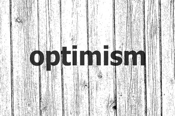 Text Optimism. Social concept . Wooden texture background. Black and white