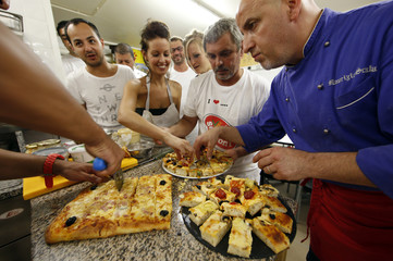 Maurizio Scalia, an Italian chef and teacher at the French pizzaiolo school, shares food with his students in Cap D'Ail
