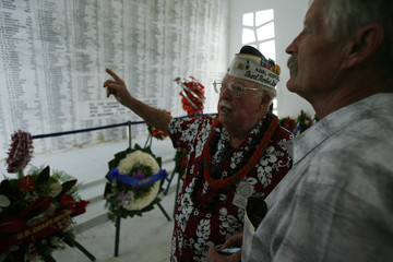 Pearl Harbor survivor Hammet points out shipmates' names to his son at 'Remembrance Wall' on USS Arizona Memorial during 71st anniversary of attack on Pearl Harbor in Honolulu