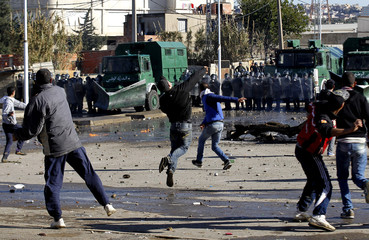 Protesters throw stones at riot gendarmerie during clashes in Cheraga, on the outskirts of Algiers