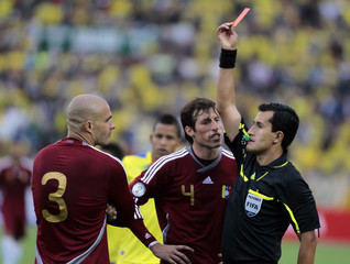 Venezuela's Rey is shown the red card by Chilean referee Osses during the World Cup 2014 qualifying soccer match against Ecuador in Quito