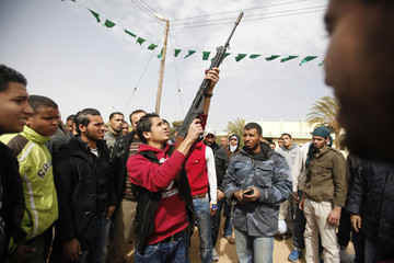 Anti-government rebels undergo weapons training at a military base in Benghazi