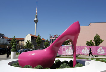 "A giant shoe is pictured outside a life-size ""Barbie Dreamhouse"" of Mattel's Barbie dolls in Berlin"