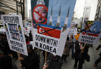 Protesters from a right-wing, conservative and anti-North Korean civic group holding banner bearing anti-North Korean message with its leader Kim Jong Un, march during an anti-North Korean rally in Seoul