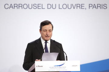 "ECB President Draghi delivers a speech during the ""Competitiveness Challenge"" meeting in Paris"