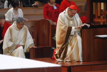 Cardinal Mahony, the Archbishop of Los Angeles Archdiocese prays as he attends Holy Mass during Christmas at Cathedral of Our Lady of the Angels In Los Angeles