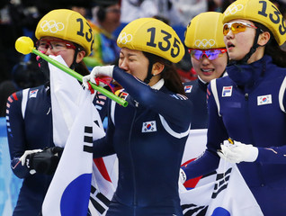 South Korea's skating team celebrates after winning the women's 3,000 metres short track speed skating relay final event in the Iceberg Skating Palace at the Sochi 2014 Winter Olympic Games