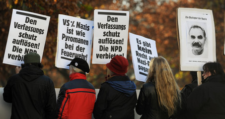 Anti-Nazi protestors walk with placards during  demonstration in Munich