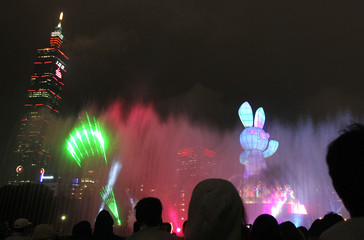 People look at a rabbit-shaped lantern during the 2011 Taipei Lantern Festival in Taipei