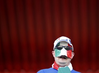 Italy fan waits for the start of a 2010 World Cup Group F soccer match against Slovakia in Johannesburg