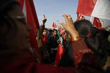 Protesters shouting slogans take part in a general strike in Kathmandu