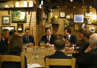 Britain's Chancellor of the Exchequer George Osborne drinks a beer during a visit to Marston's Brewery in Burton upon Trent, central England