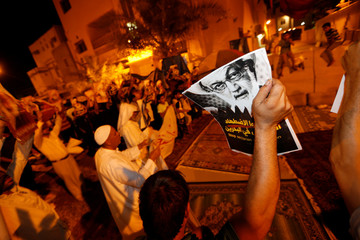 Protesters holding photos of Bahrain's leading Shi'ite cleric Isa Qassim shout religious slogans during a sit-in outside his home in the village of Diraz west of Manama