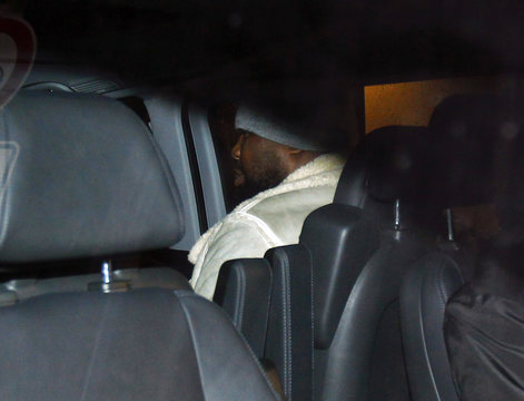 British boxer Dereck Chisora and his coach Don Charles leave Munich's main police station on a van with tinted windows