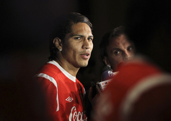 Peru's national soccer player Paolo Guerrero speaks to the media after a practice session in Buenos Aires