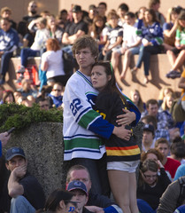 Canucks fans react to a Bruins goal while watching the NHL Stanley Cup Final on a big screen in Vancouver