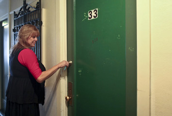 Hotel manager Robin Brekhus enters room 333, one of the most haunted rooms of the Gadsden Hotel in Douglas
