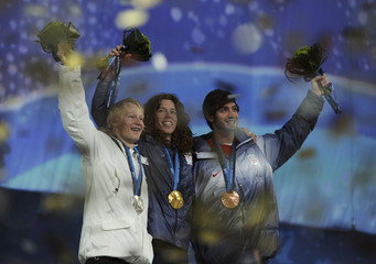 Medallists wave during the medal ceremony for the men's snowboard halfpipe competition at the Vancouver 2010 Winter Olympics