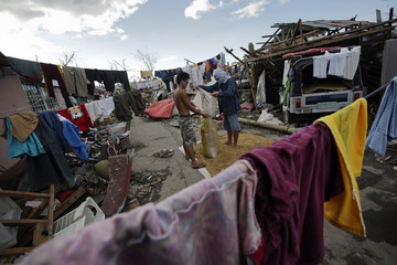 Survivors dry rice in a part of Tanauan devastated by Typhoon Haiyan