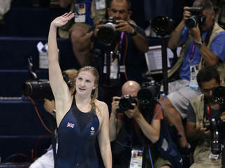 Britain's Rebecca Adlington waves after winning bronze in the women's 400m freestyle final at the London 2012 Olympic Games at the Aquatics Centre