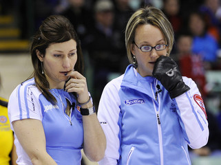 Quebec's Nicholls and skip Larouche consider their next shot during their draw against New Brunswick at the Scotties Tournament of Hearts curling championship in Red Deer