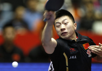 China's Ma hits return to Russia's Paykov during World Team Table Tennis Championships in Tokyo