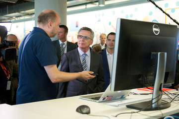 German Interior Minister de Maiziere visits the Facebook office in Berlin