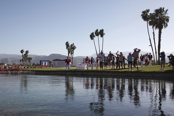 Lewis of U.S. celebrates winning LPGA Kraft Nabisco Championship golf tournament by jumping into Poppie's Pond in Rancho Mirage, California